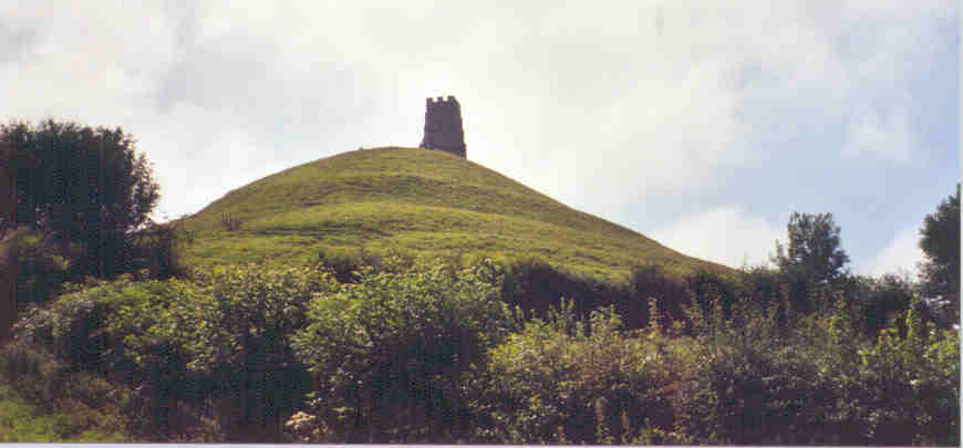 Glastonbury Tor, the legendary Isle of Avalon, where Arthur is said to have died.  It is now believed that the area surrounding this Tor was under water in the 5th century.  The ruins of the church on top were built much later.