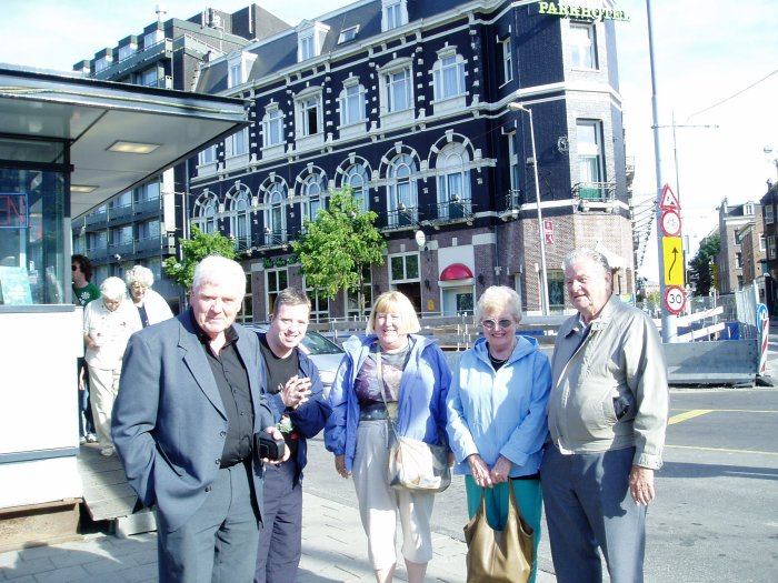 From left to right, Cousin Frank Lane, his son Vincent, my sister Carol, Mom and Dad.  We met our Irish cousins briefly in Amsterdam.  We stayed at the Park Hotel (behind us).