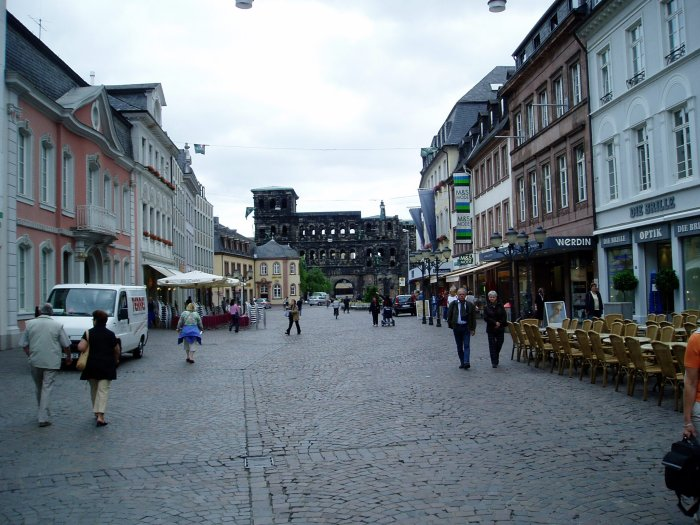 Trier, Germany.  The Porta Nigra, a colossal Roman gate, can be seen at the end of the street.