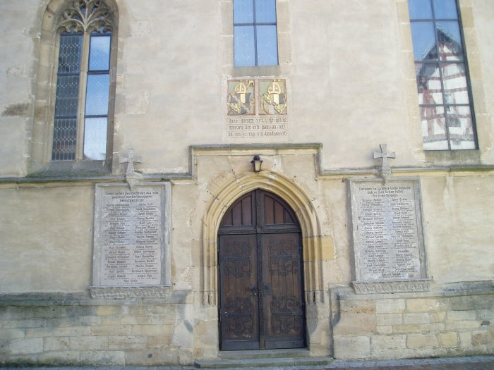 Church in Ofterdingen, Germany.  On either side of the door are memorials listing the townsmen who died in World War I.