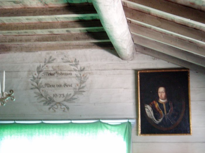 Inside an old Skansen house – note the date carved on the wall: 1673